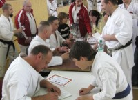 The Instructors signing Course Certificates